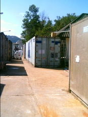 The shipping containers storing the victims.