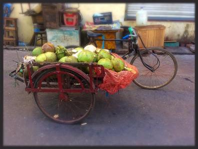 Rickshaw with fruit for market - down-town Yangon